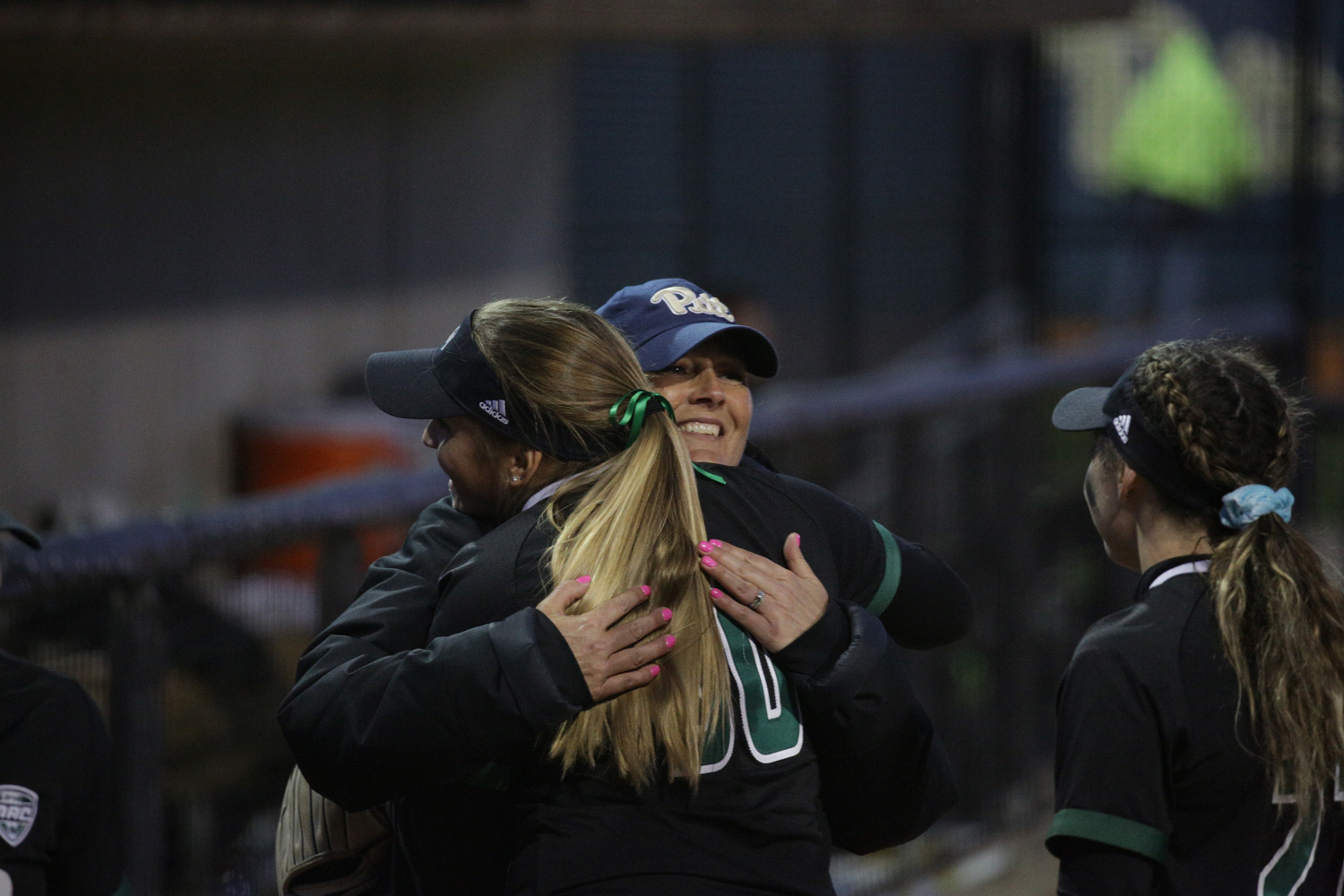 Head coach Jodi Hermanek congratulates her former Ohio University team after Pitt's 11-9 overtime loss.