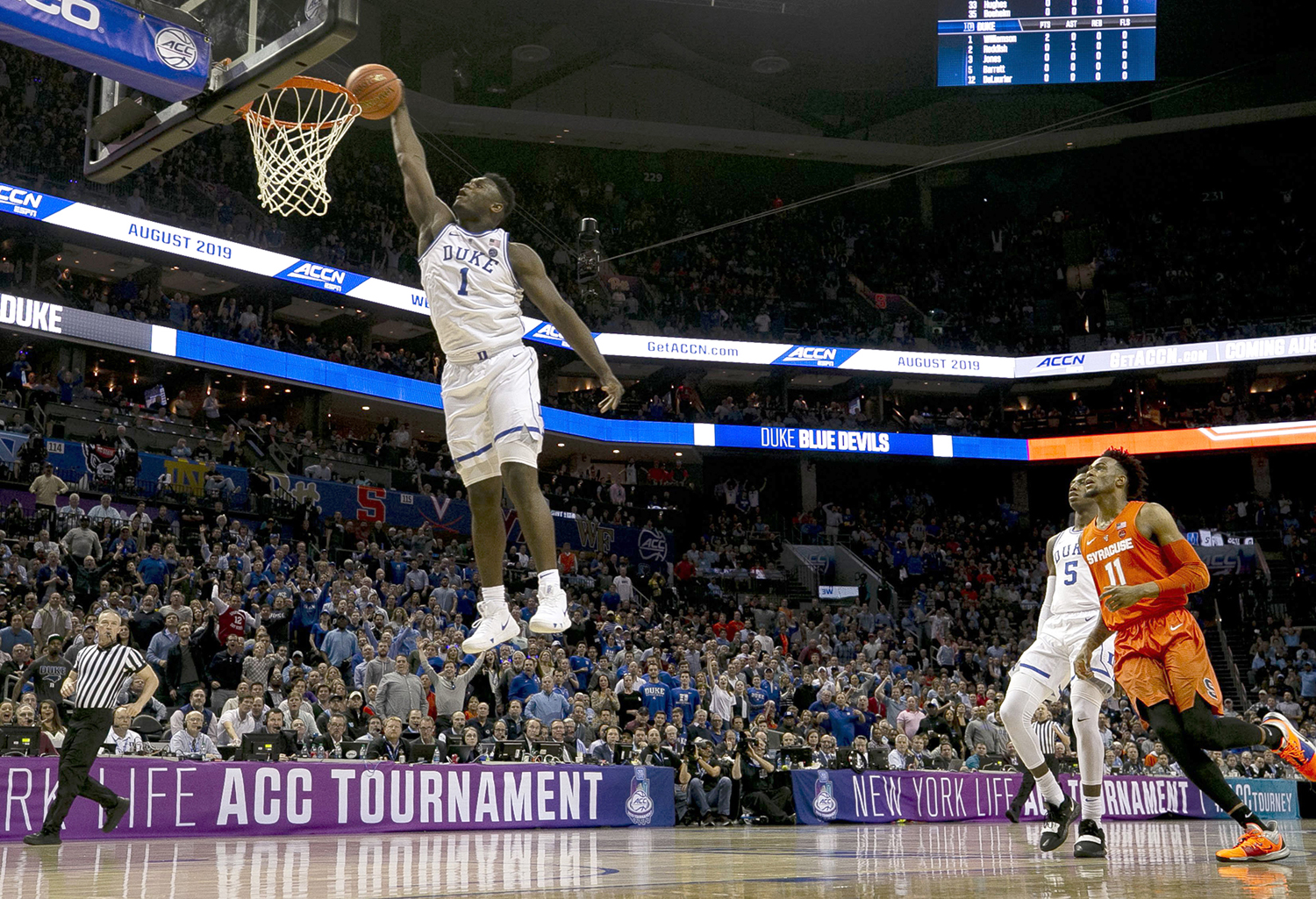 Duke's Zion Williamson (1) glides to the basket for a dunk in the opening minutes of play against Syracuse in the quarterfinals of the ACC Tournament at the Spectrum Center in Charlotte, North Carolina, on March 14.
