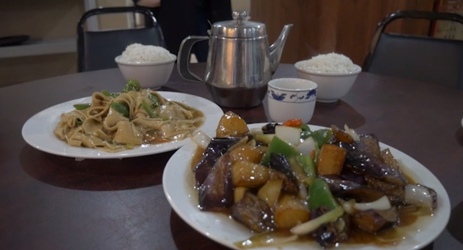 Squirrel Hill's Northeast Kitchen serves Stir Fried Eggplant, Potato, and Green Pepper (right), and Dried Tofu with Chili Pepper.