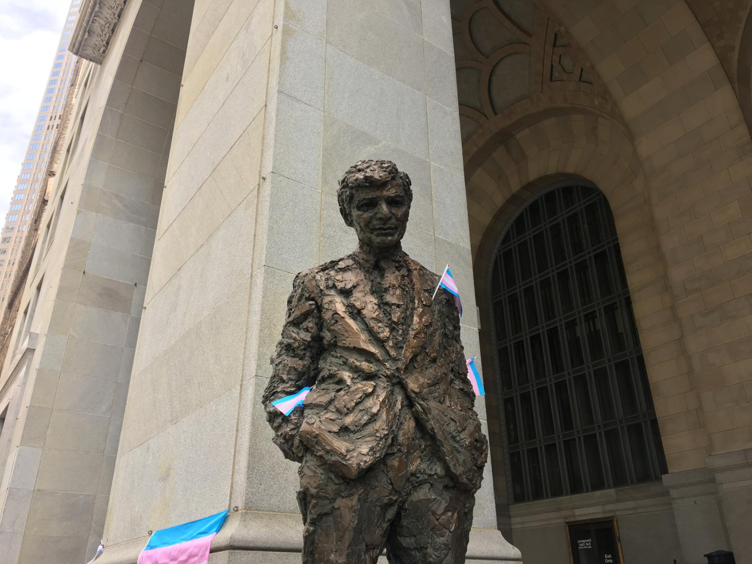 Transgender rights activists placed transgender pride flags on a statue of former Pittsburgh mayor Richard Caliguiri.