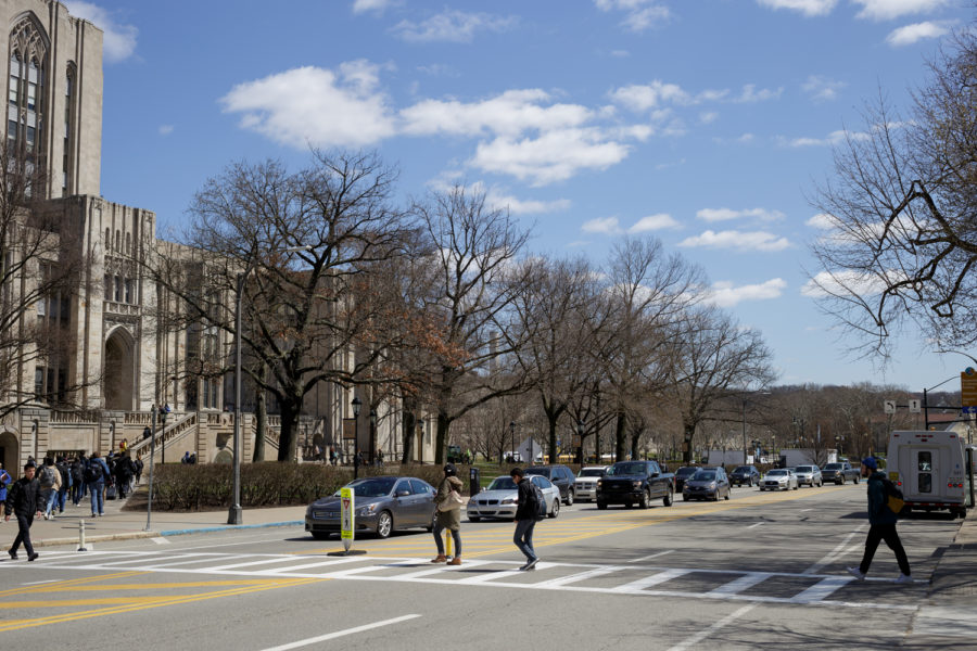 Students cross Bigelow Boulevard in between afternoon classes on Monday.