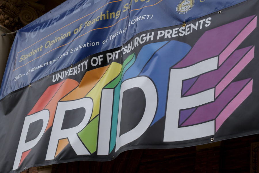 Pitt+Pride+banner+outside+of+the+William+Pitt+Union.%0A