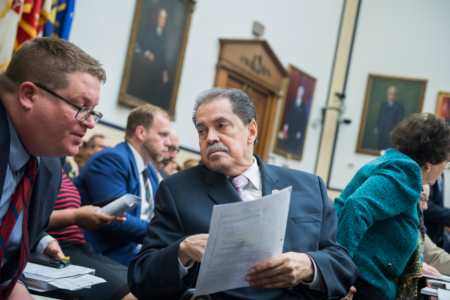 Rep. Jose Serrano, D-N.Y., talks with an aide during a House Appropriations Committee mark up of the FY 2019 Commerce, Justice and Science Appropriations bill in Rayburn Building on May 17, 2018.