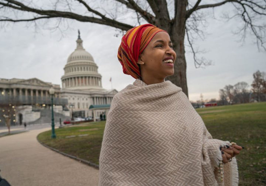 U.S.+Rep.+Ilhan+Omar%2C+D-Minn.%2C+walking+from+her+new+office+in+the+Longworth+House+Office+Building+to+the+U.S.+Capitol%2C+a+few+hours+before+being+sworn+in+as+a+member+of+Congress.+%0A