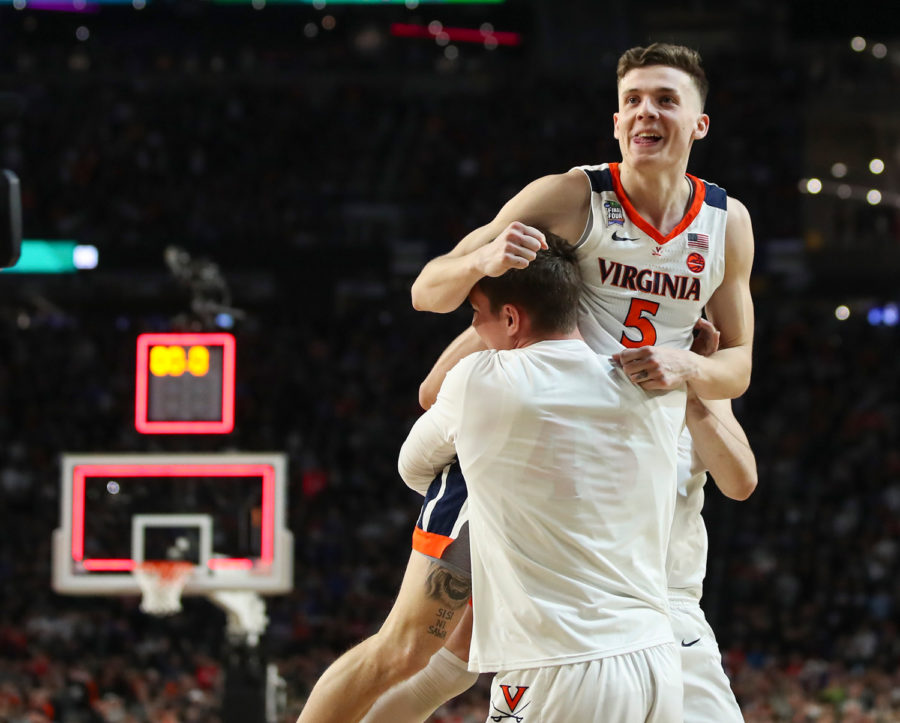 Virginia%27s+Kyle+Guy+%285%29+is+lifted+off+the+floor+by+teammates+after+he+sunk+three+free+throws+to+win+the+game+for+Virginia+against+Auburn+in+a+semifinal+of+the+NCAA+Tournament+Final+Four+on+Saturday%2C+April+6%2C+at+U.S.+Bank+Stadium+in+Minneapolis.+Virginia+advanced%2C+63-62.%0A