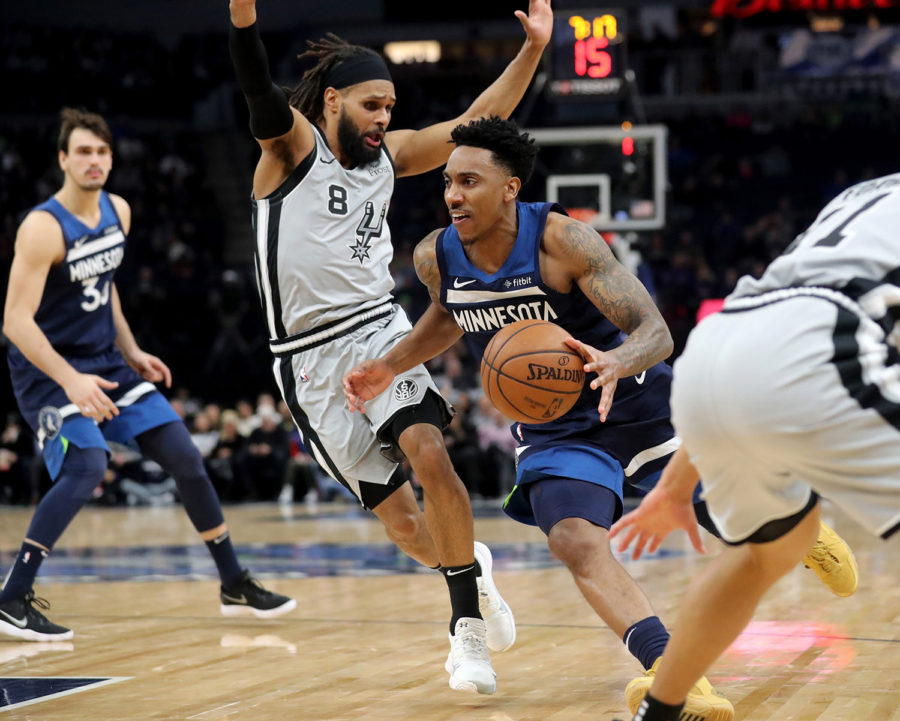 The+Minnesota+Timberwolves%27+Jeff+Teague+%280%29+drives+against+the+San+Antonio+Spurs%27+Patty+Mills+%288%29+during+the+second+half+on+Friday%2C+Jan.+18+at+the+Target+Center+in+Minneapolis.+The+Spurs+won%2C+116-113.%0A
