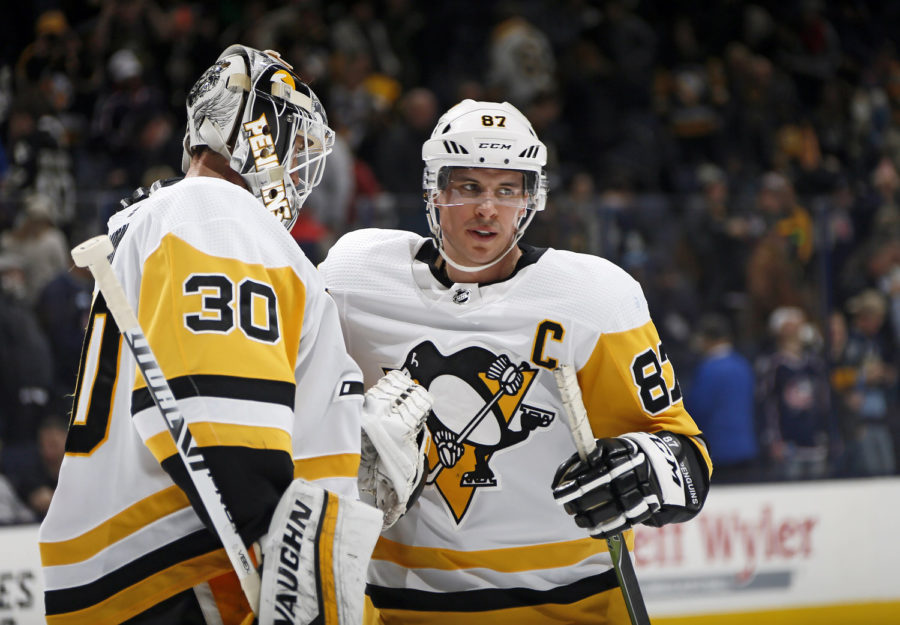 Pittsburgh Penguins center Sidney Crosby (87) hugs goaltender Matt Murray (30) following the NHL game against the Columbus Blue Jackets at Nationwide Arena Feb. 26, 2019 in Columbus, Ohio.