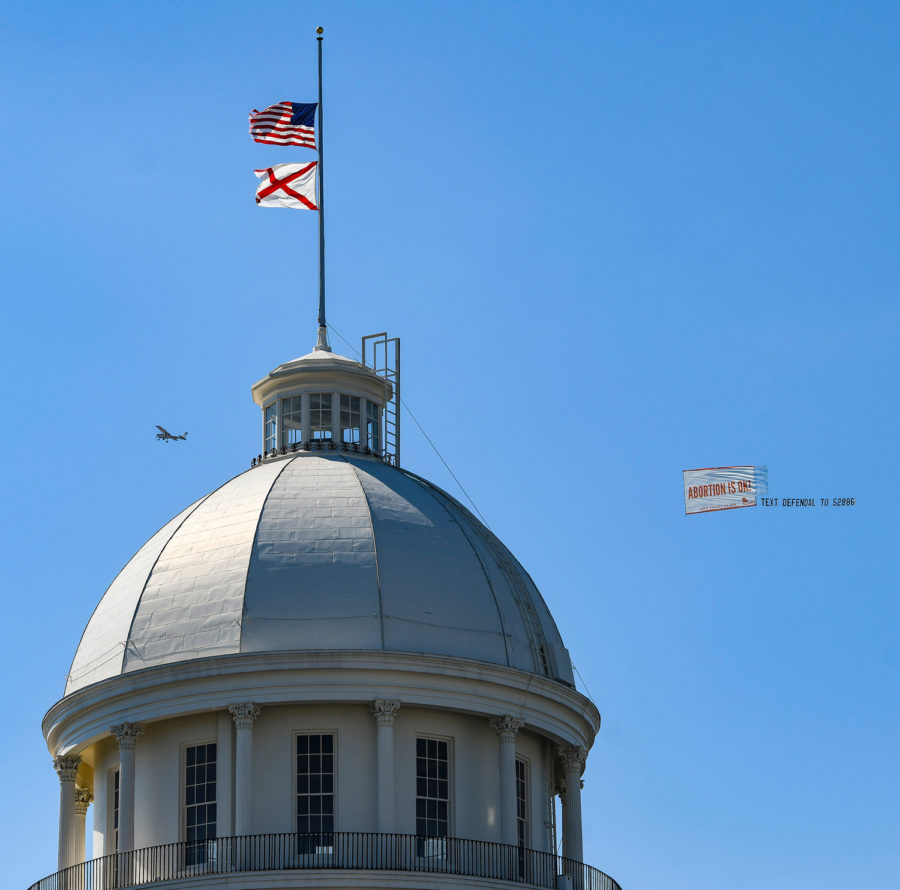 An+airplane+displaying+a+banner+reading+%22Abortion+Is+OK%22+circles+the+Alabama+State+Capitol+on+May+15%2C+in+Montgomery%2C+Alabama%2C+the+same+day+Alabama+Gov.+Kay+Ivey+signed+a+near-total+ban+on+abortion+into+state+law.+%0A
