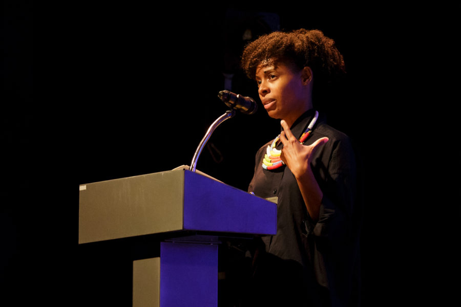 Poet+Nicole+Sealey+reads+her+poem+%E2%80%9CCandelabra+With+Heads%E2%80%9D+at+Pitt%E2%80%99s+Center+for+African+American+Poetry+and+Poetics+%E2%80%9CWon%E2%80%99t+You+Celebrate+With+Me%E2%80%9D+event+on+Saturday+evening.%0A