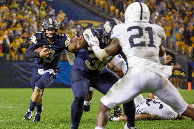 Junior quarterback Kenny Pickett scrambles during Pitt's 2018 loss to Penn State.