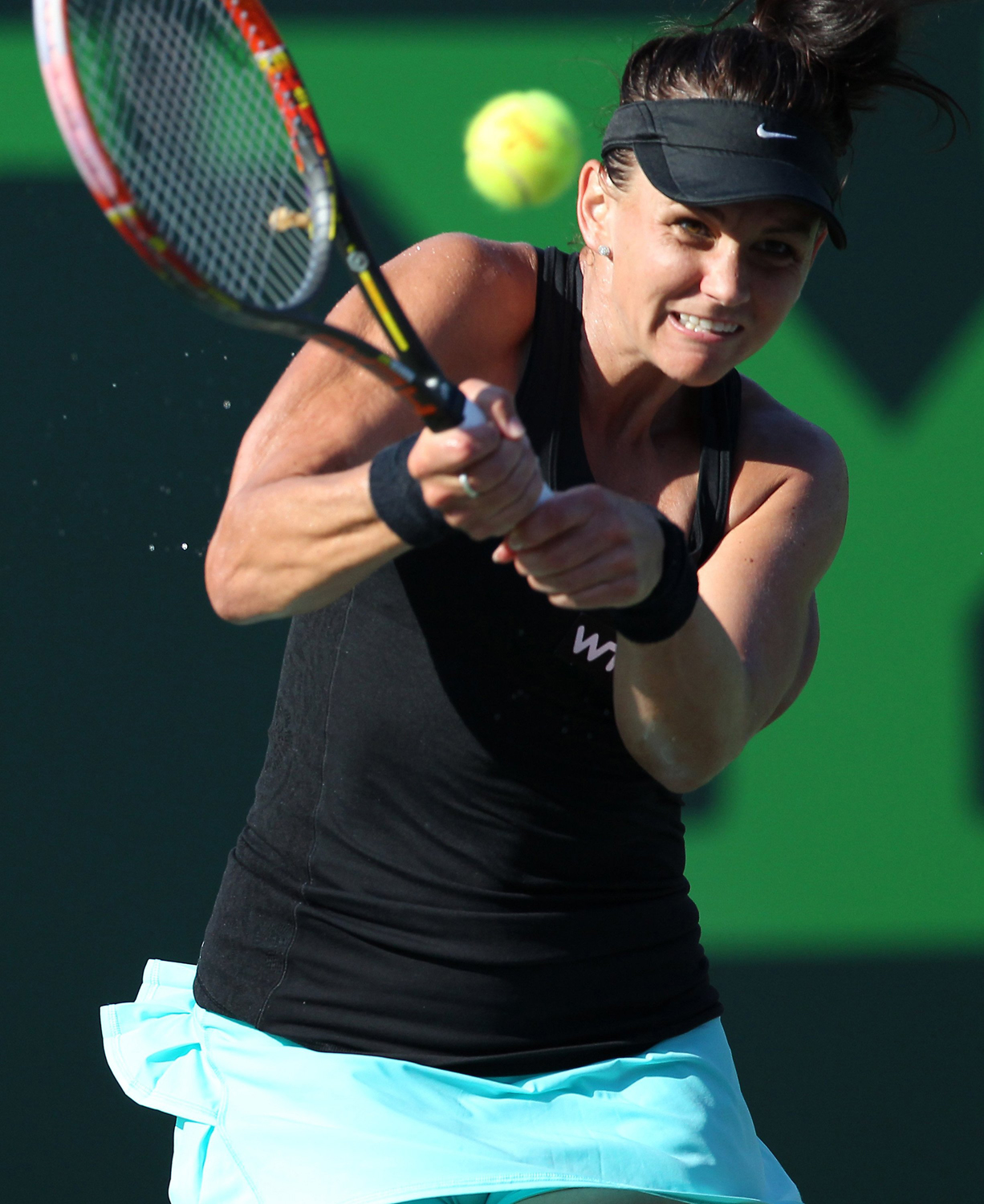 Australia's Casey Dellacqua returns the ball to USA's Venus Williams during the Sony Open tennis tournament in Key Biscayne, Florida, on Sunday, March 23, 2014.
