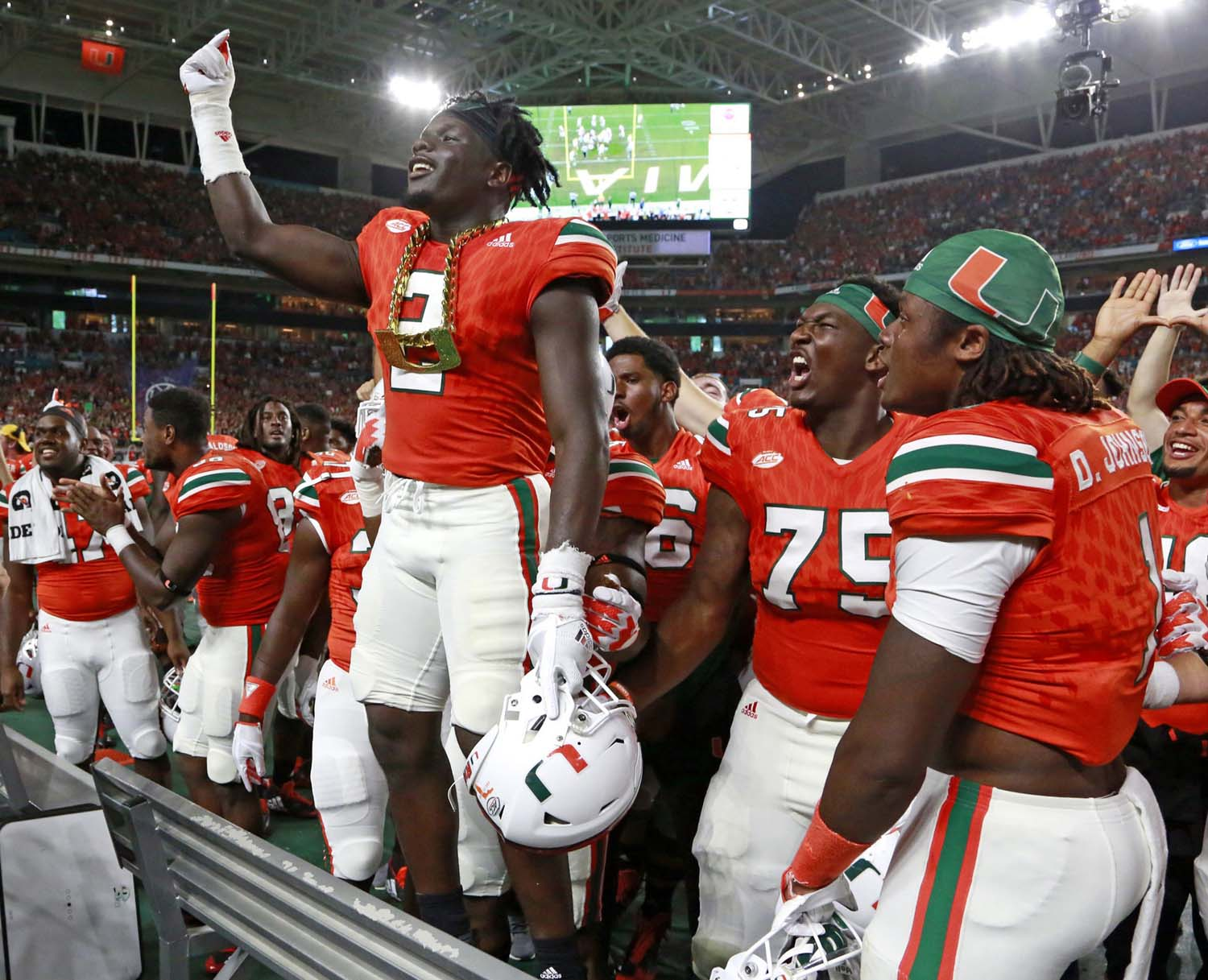 Miami Hurricanes defensive back Trajan Bandy wears the team's iconic turnover chain.