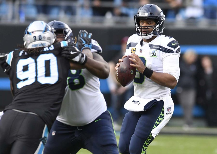 Seattle+Seahawks+quarterback+Russell+Wilson+%283%29+looks+to+throw+downfield+against+the+Carolina+Panthers+in+the+second+half+on+Sunday%2C+Nov.+25%2C+2018%2C+at+Bank+of+America+Stadium+in+Charlotte%2C+North+Carolina.+%0A