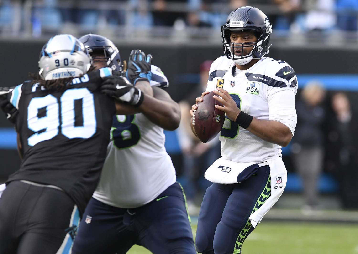 Seattle Seahawks quarterback Russell Wilson (3) looks to throw downfield against the Carolina Panthers in the second half on Sunday, Nov. 25, 2018, at Bank of America Stadium in Charlotte, North Carolina.
