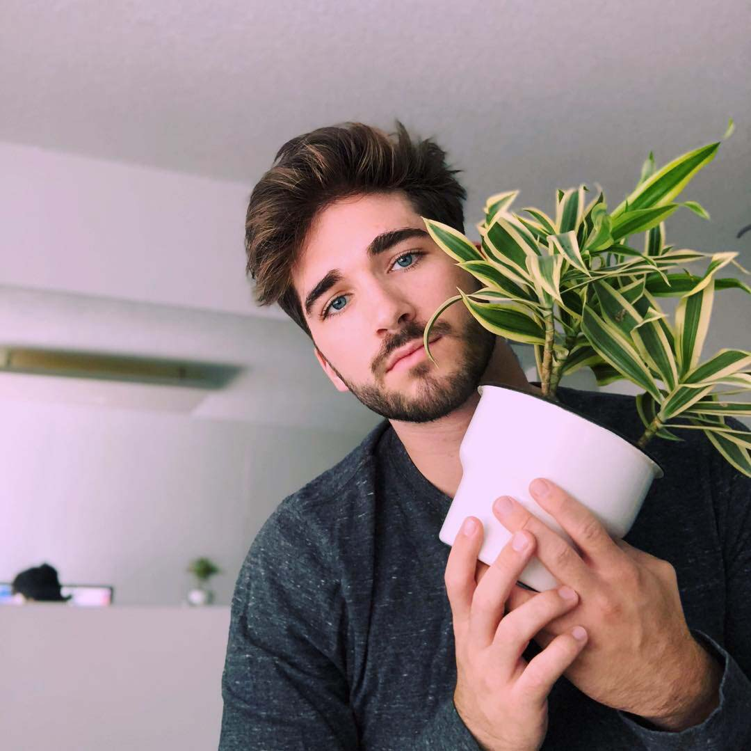 Cole Boillat poses with his plant, Jonathan.