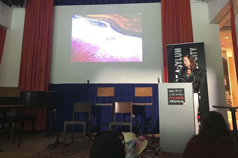 "Paisley Rekdal, Utah's poet laureate, reads while on stage at City of Asylum's ""Poet Laureate Celebration"" on Monday afternoon."