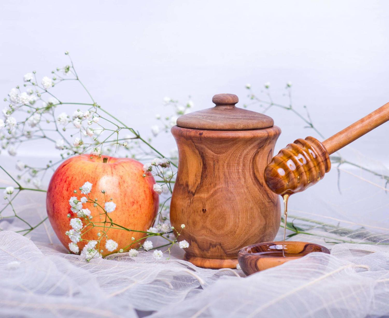 The Rosh Hashanah meal begins with the dipping of apple into honey and a special blessing for