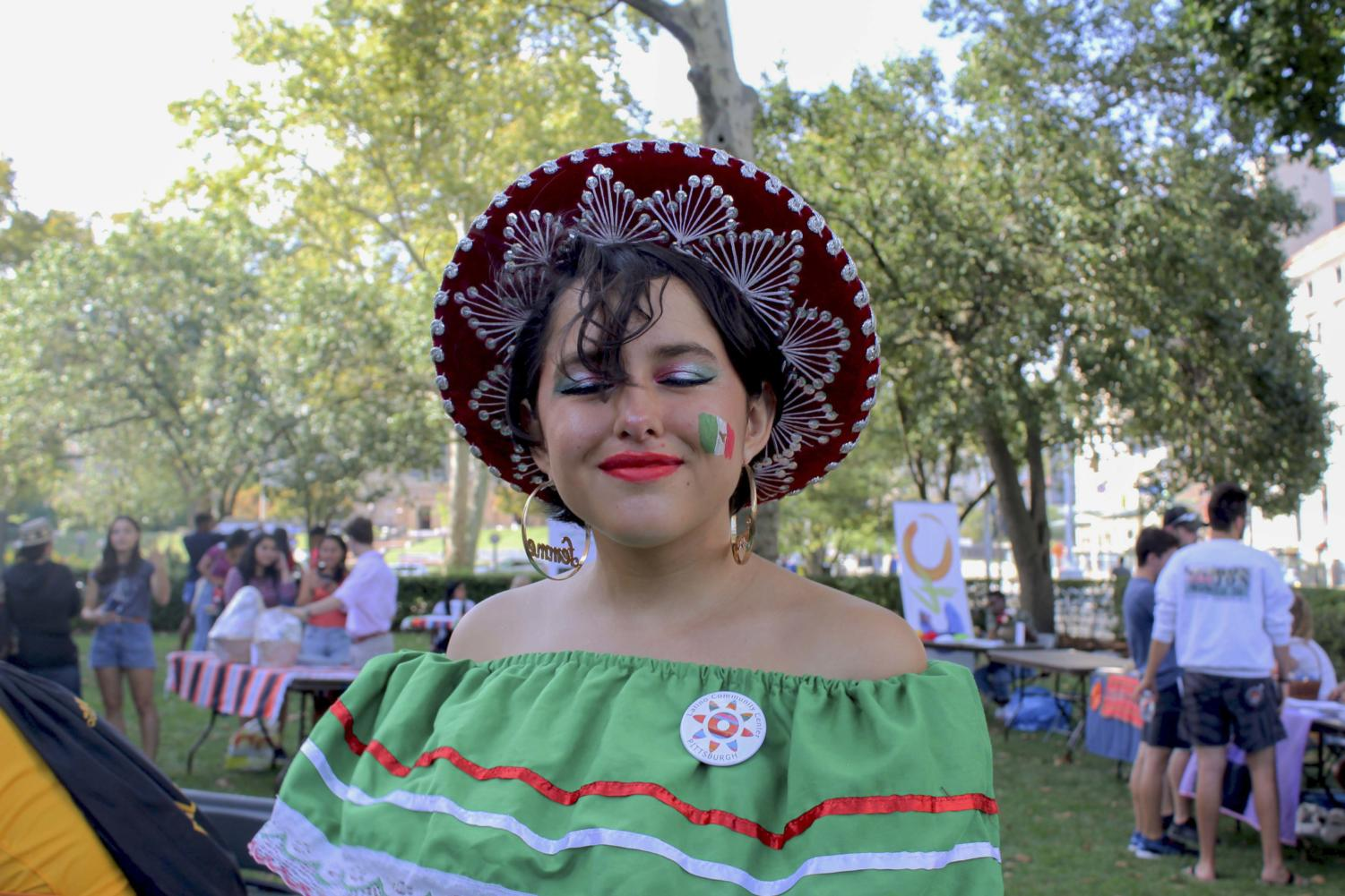 First-year Mia Moore poses in face paint and traditional dress at the kickoff to Hispanic Heritage Month.