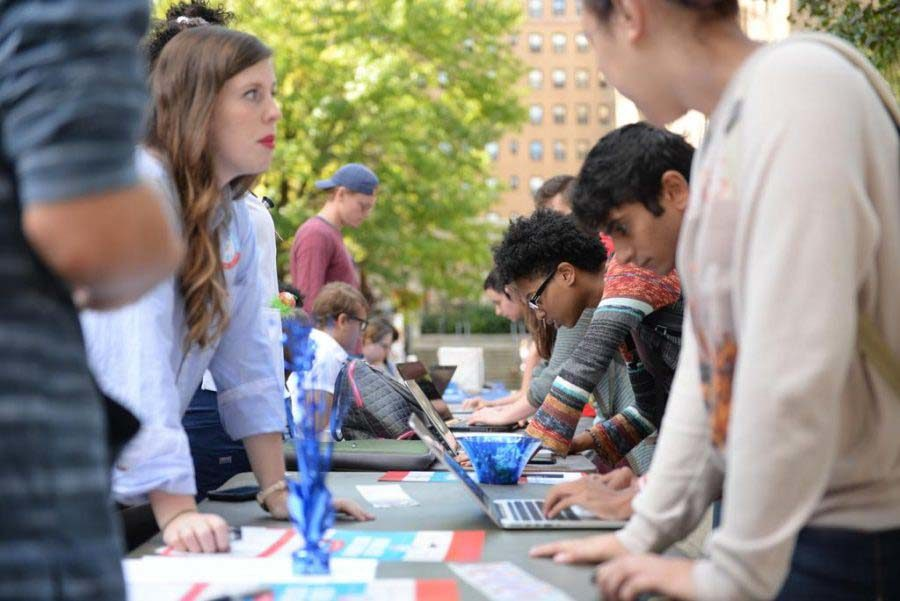 Pitt students line up to register to vote outside the William Pitt Union.