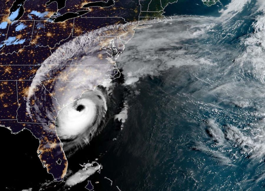 Dorian+lashed+the+Carolinas+with+driving+rain+and+winds+as+it+neared+the+U.S.+east+coast+Thursday+after+devastating+the+Bahamas+and+killing+at+least+20+people.+Up+to+20+inches+of+rain+were+forecast+and+forecasters+warned+of+flash+flooding.+