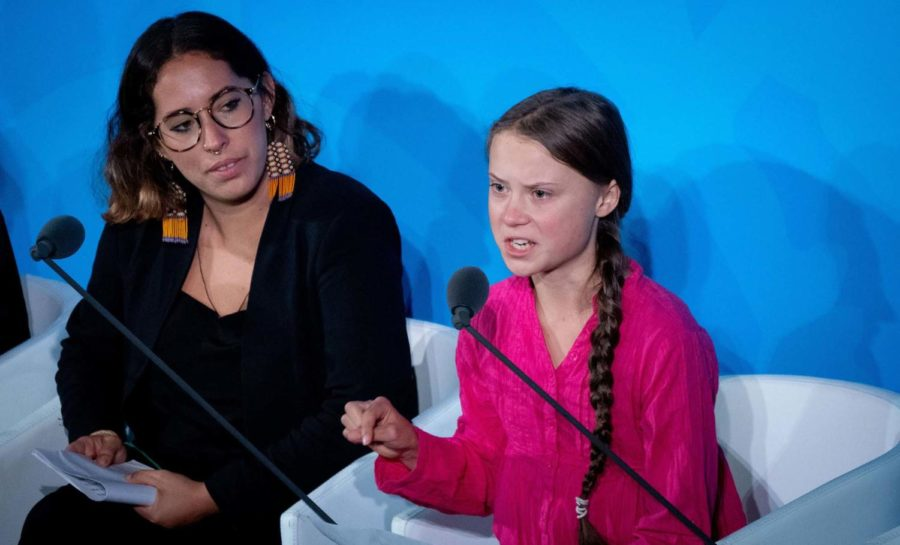 Climate activist Greta Thunberg, right, speaks at the United Nations Climate Change Conference on Monday in New York City.
