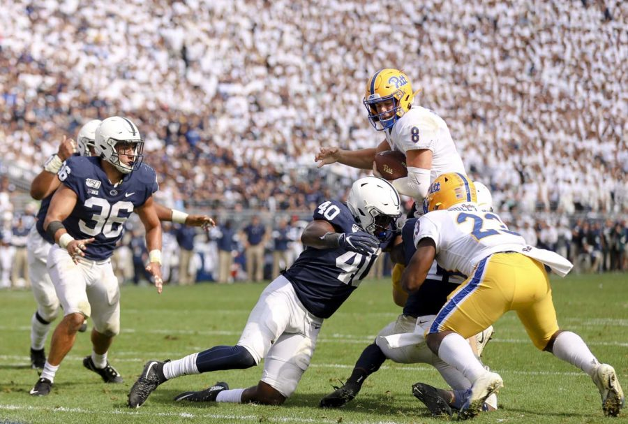Junior quarterback Kenny Pickett (8) is tackled for a loss right outside of the Penn State goal line.
