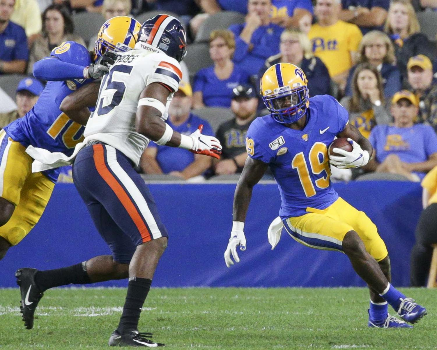 Sophomore wide receiver V'Lique Carter (19) pushes for yardage against Virgina at the season opener on Aug. 31.