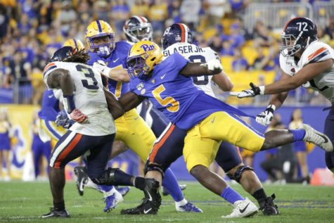 Redshirt sophomore Deslin Alexandre (5) will play as a defensive lineman this season after junior Rashad Weaver went down with a season-ending knee injury during training camp.