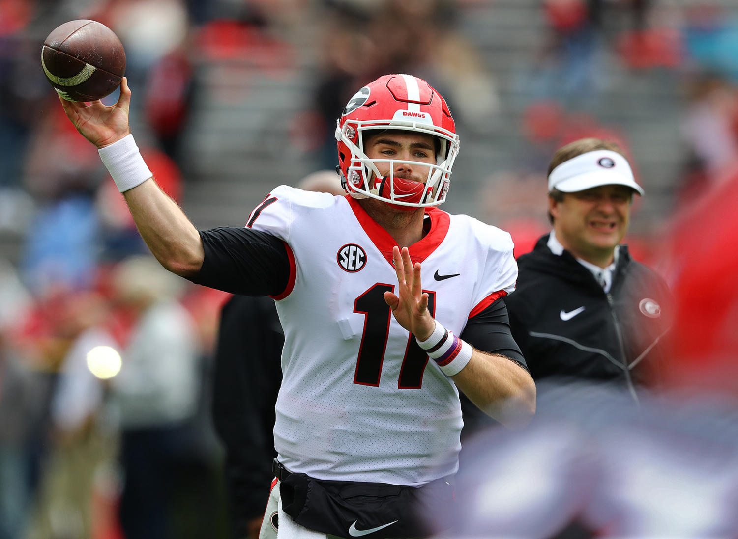 Georgia head coach Kirby Smart looks on while Jake Fromm (11) throws a pass during the annual G-Day scrimmage on Saturday, April 20 at Sanford Stadium in Athens, Georgia.