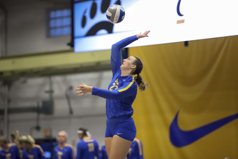 Kayla Lund (23) serves the ball