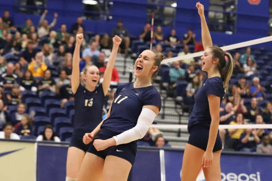 Senior Layne Buskirk (right) recorded three kills in the first set, contributing to a team hitting percentage of .520 against UVA.