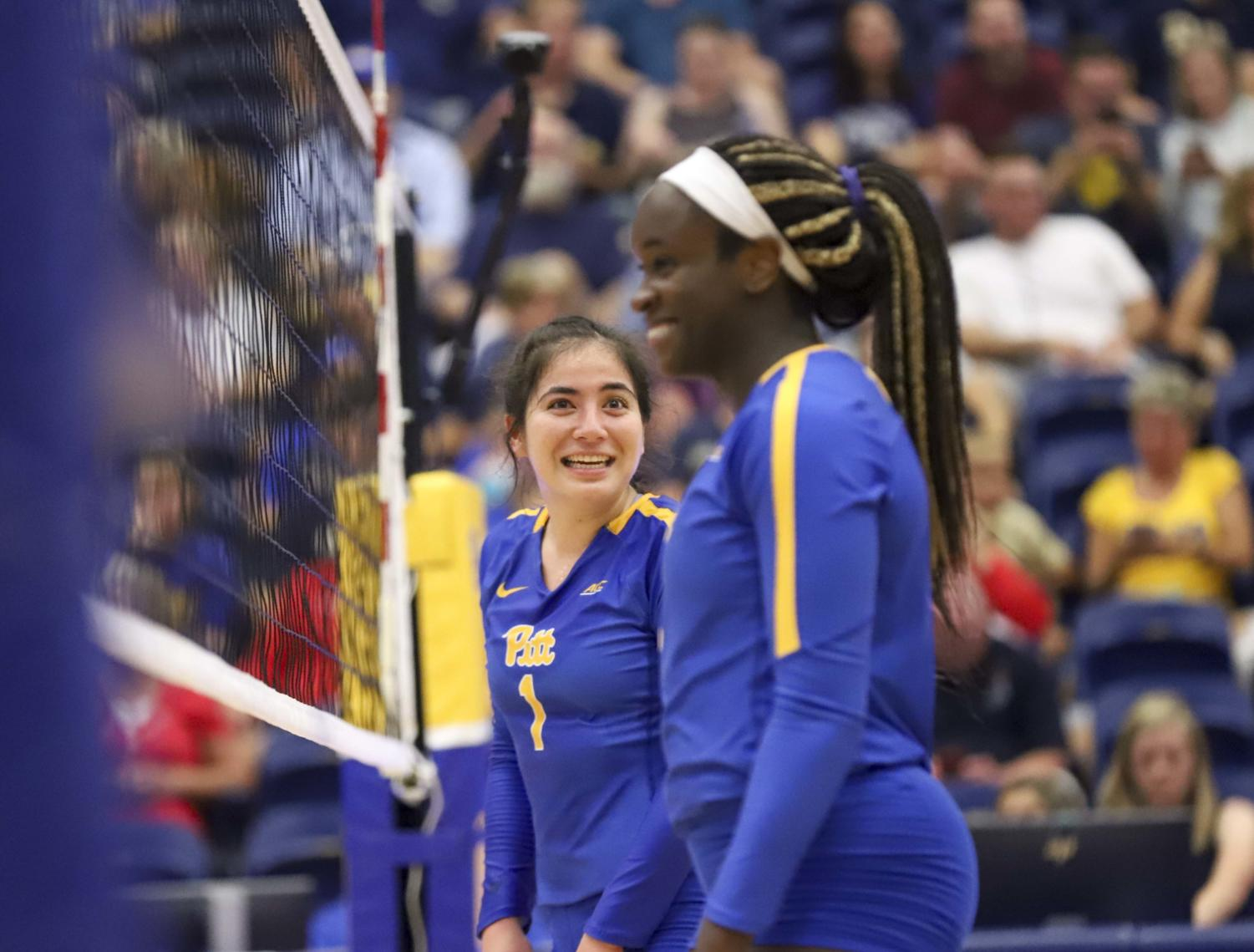 First-year Lexis Akeo (1) talks with teammate Chinaza Ndee.