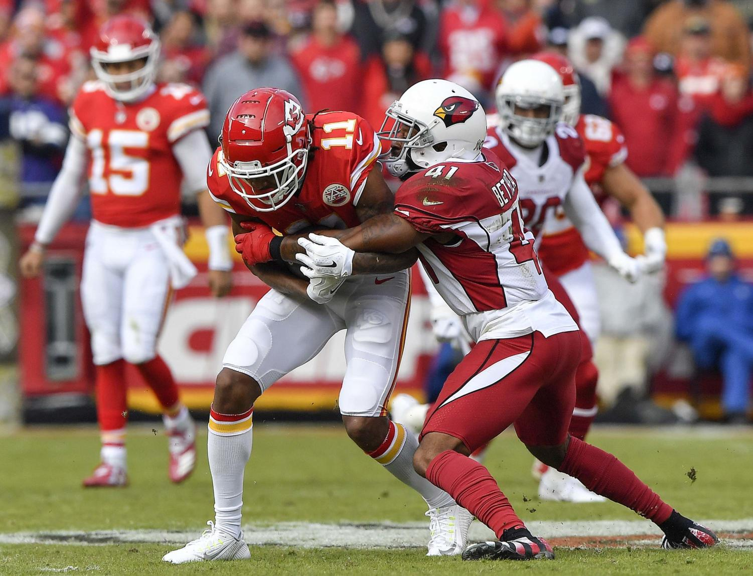 Kansas City Chiefs wide receiver Demarcus Robinson picks up a first down before being stopped by Arizona Cardinals free safety Antoine Bethea in the first quarter on Sunday, Nov. 11, 2018 at Arrowhead Stadium in Kansas City, Missouri.