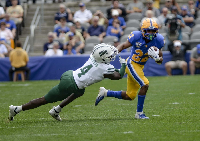 First-year halfback Vincent Davis stiff arms junior Ohio cornerback Jamal Hudson.