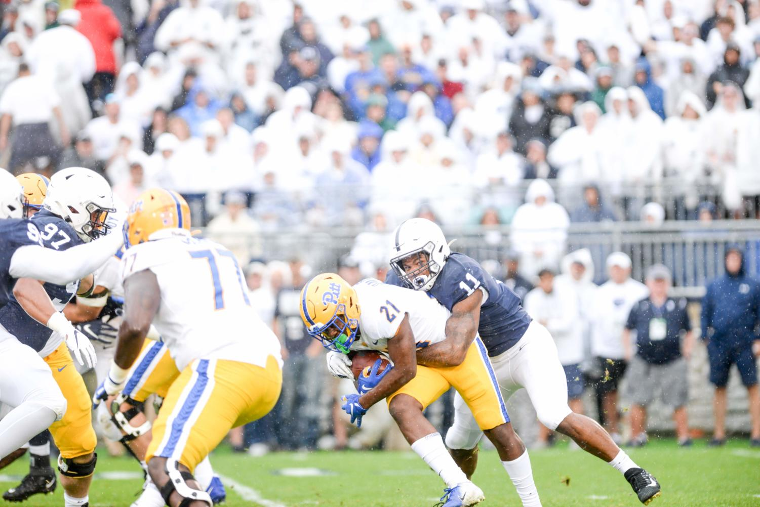 Junior running back AJ Davis is tackled in the backfield.