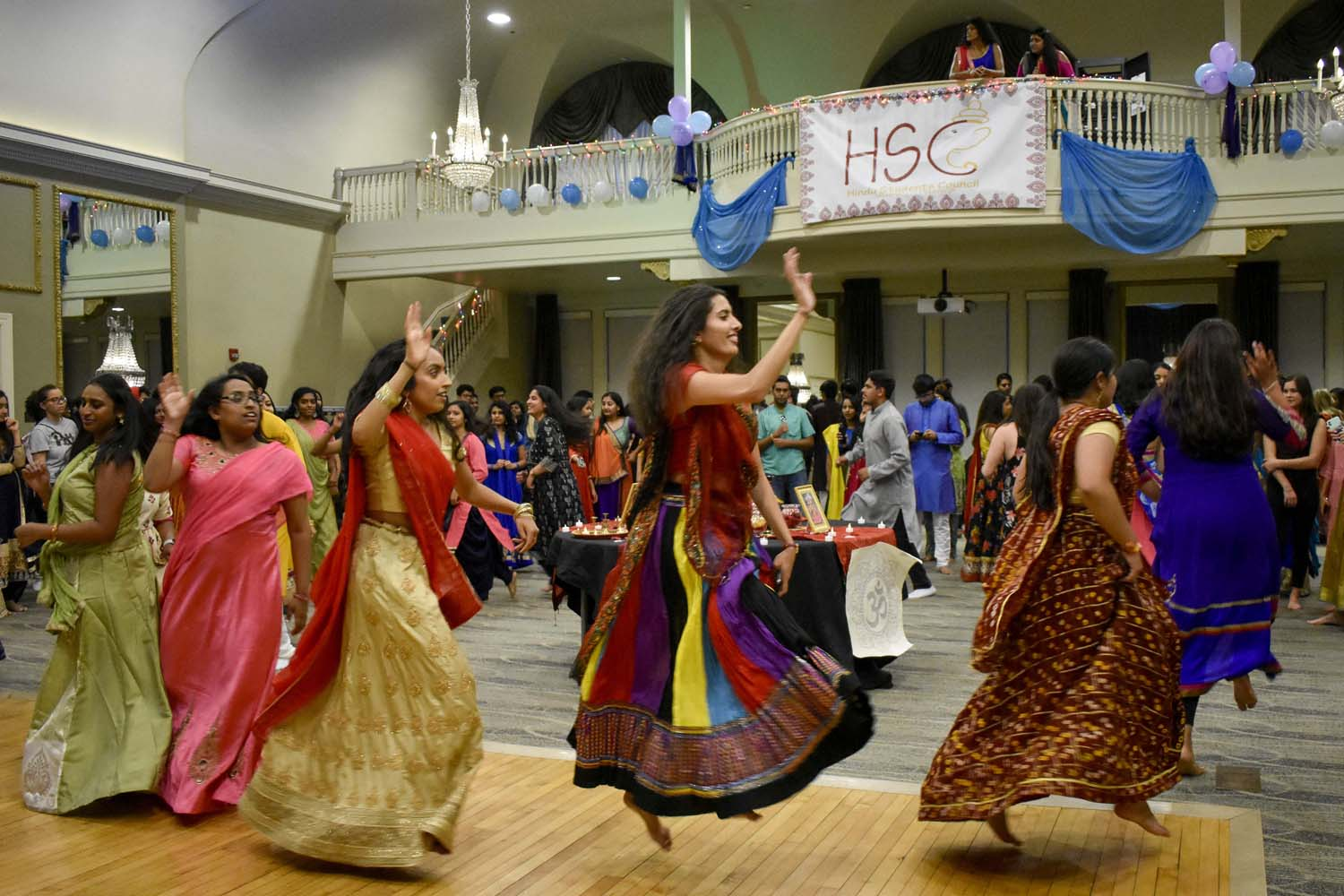 Participants dance in circles in the O'Hara Student Center ballroom during the Hindu Students Council's Navaratri celebration.