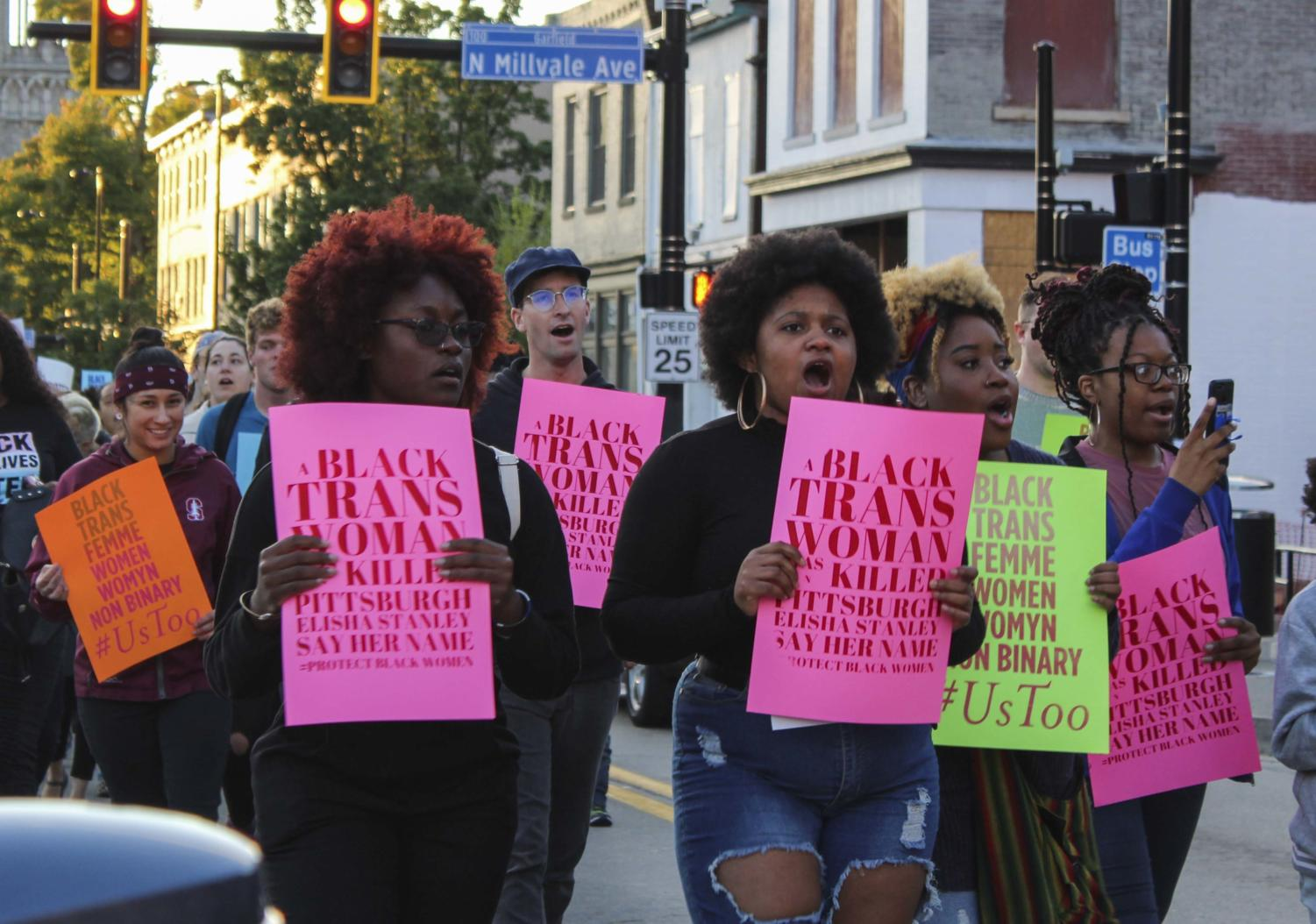 About 100 people met at the intersection of Main Street and Penn Avenue in Bloomfield Friday evening to show support for black and trans women.