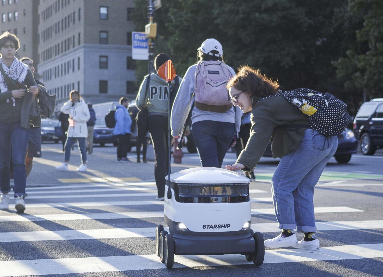 Starship's food delivery robots have been criticized for creating difficulties at crosswalks for wheelchair-using students.