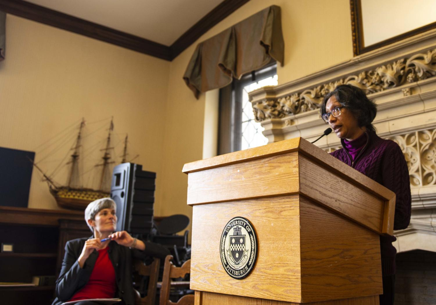 Amy Wildermuth (left) looks on as Shanti Gamper-Rabindran discusses current issues in environmental policy at the Green Speakeasy event in the University Club Library Wednesday afternoon.