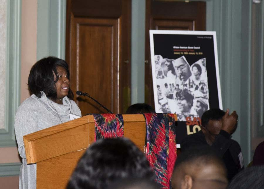 """Nicole Walker Parks, African American Alumni Council President, welcomes guests at """"Say It Loud"""" in January."""