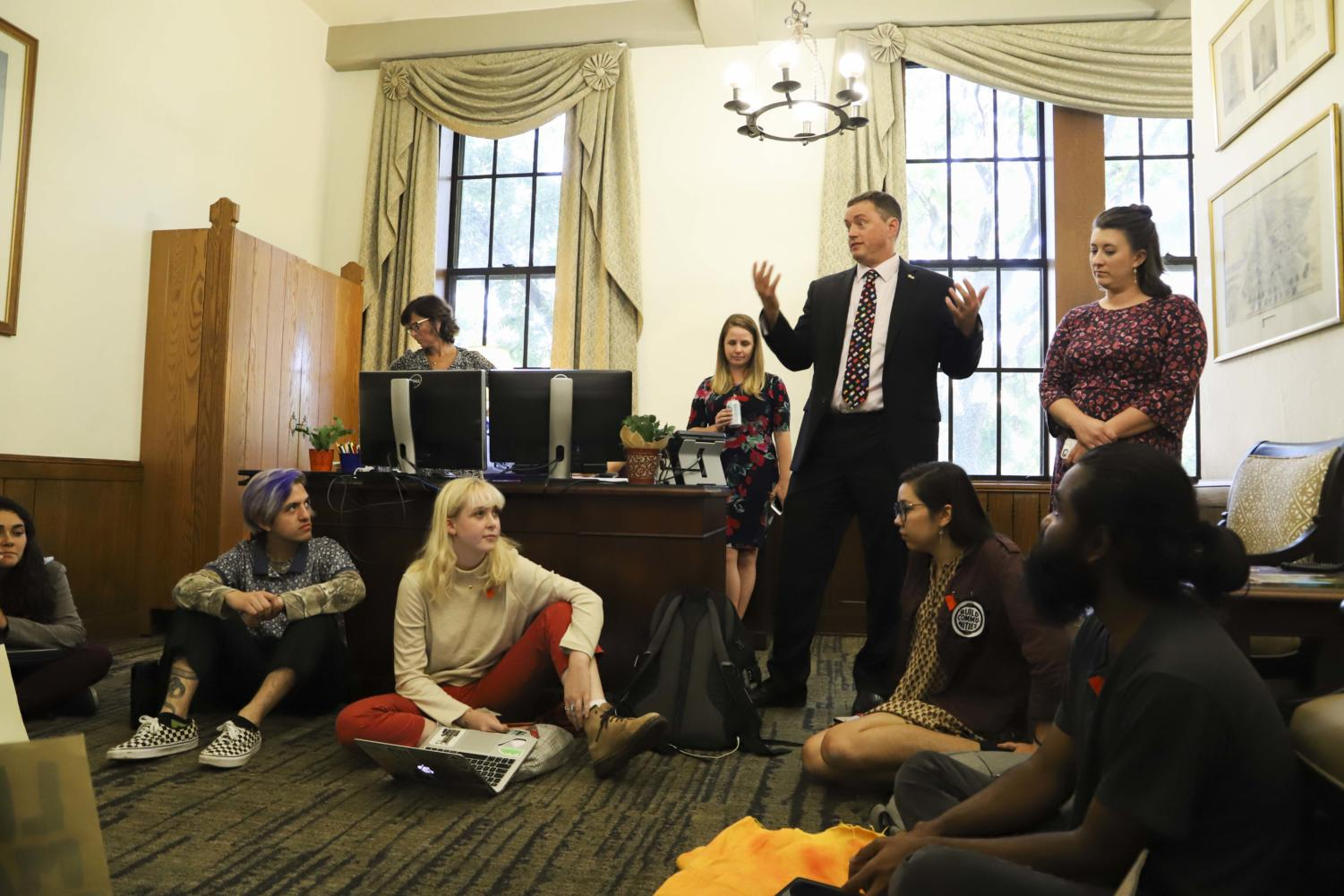 Associate Dean of Students Steve Anderson tells members of the Fossil Free Pitt Coalition that they cannot have a sit-in demonstration in the chancellor's office.