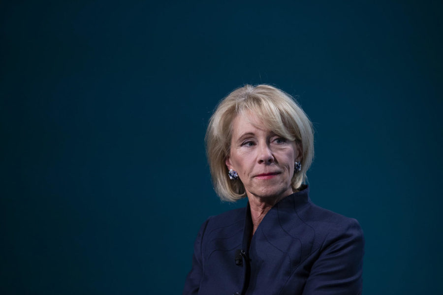 Betsy+DeVos%2C+secretary+of+education%2C+speaks+during+the+Wall+Street+Journal+CFO+Network+conference+in+Washington%2C+D.C.%2C+on+Tuesday%2C+June+11.+