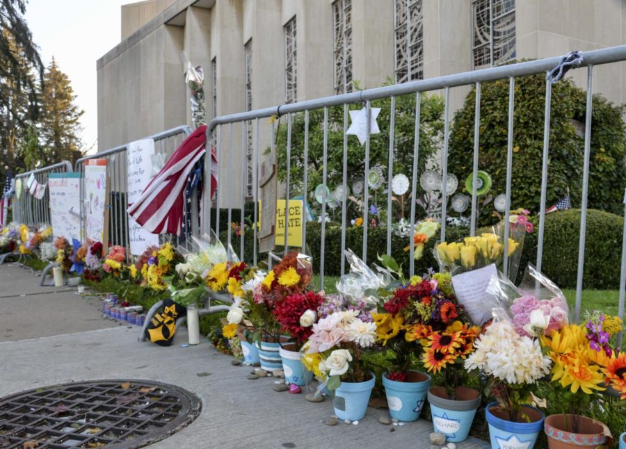 Flowers, candles and chalk drawings were placed outside the Tree of Life Synagogue on Sunday afternoon.