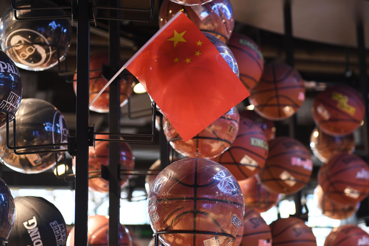 The Chinese flag is seen with a display of basketballs at the NBA store in Beijing on Oct. 9.