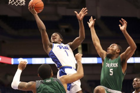 Sophomore guard Xavier Johnson (1) attacks the hoop during Pitt's 98-47 victory over Slippery Rock.