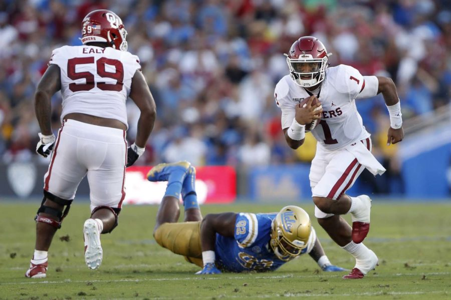 Jalen Hurts (1) of the Oklahoma Sooners breaks free on a run from Osa Odighizuwa (92) of the UCLA Bruins during the first half of a game on at the Rose Bowl on Sept. 14 in Los Angeles.