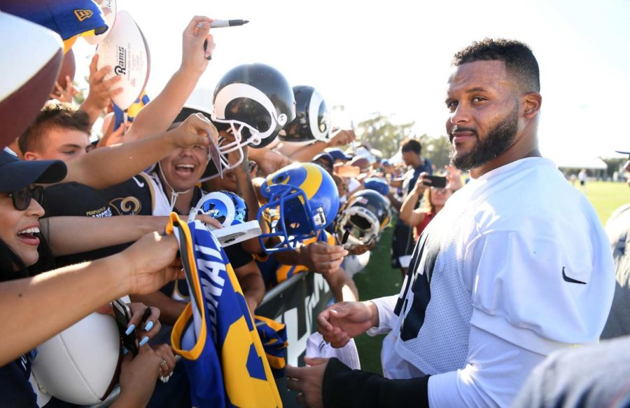 Los Angeles Rams defensive tackle Aaron Donald signs autographs during the first day of training camp in Irvine, California, on July 29.