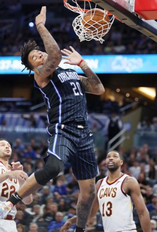 The Orlando Magic's Markelle Fultz (20) soars above Cleveland Cavaliers defenders for a thunderous slam dunk at the Amway Center in Orlando, Florida, on Wednesday, Oct. 23. The Magic won, 94-85.