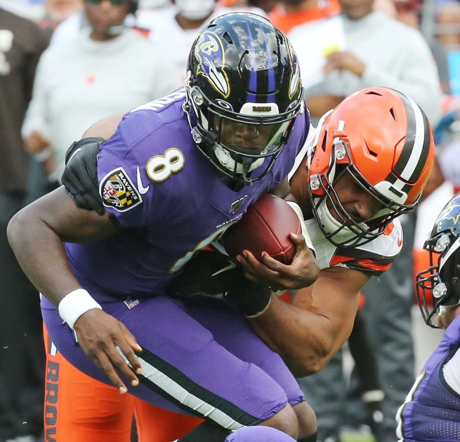 Cleveland Browns defensive end Olivier Vernon sacks Baltimore Ravens quarterback Lamar Jackson in the first quarter, Sept. 29, at M&T Bank Stadium.
