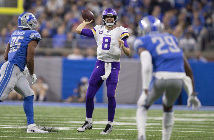Vikings+quarterback+Kirk+Cousins+prepares+to+pass+during+the+NFL+game+against+the+Detroit+Lions+on+Oct.+20+in+Detroit.+%0A